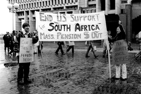 Anti Apartheid demonstrators at City Hall Plaza in Boston MA demand Massachusetts pension fund monies be divested from companies doing business in South Africa September 16,1981