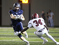 Hudson Brewer (22) of Springdale Har-ber runs ball as Zamarion Manuel (34) of Springdale tries to make tackle on  Friday, Oct. 8, 2021, during the first half of play at Wildcat Stadium in Springdale. Visit nwaonline.com/211009Daily/ for today's photo gallery.<br /> (Special to the NWA Democrat-Gazette/David Beach)