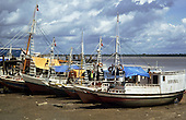 Belem, Para State, Brazil. Riverboats lined up at the side of the river on the shore.