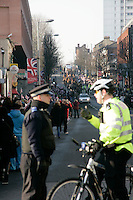 Police talk as the King's Troop Royal Horse Artillery march through Woolwich on their way to their new home nearby 2012