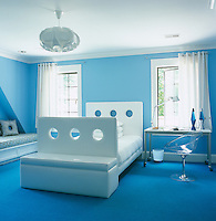 """The modern blue and white bedroom has a bespoke """"see-through"""" bed by Alison Spear and Ero/S/ desk chair"""