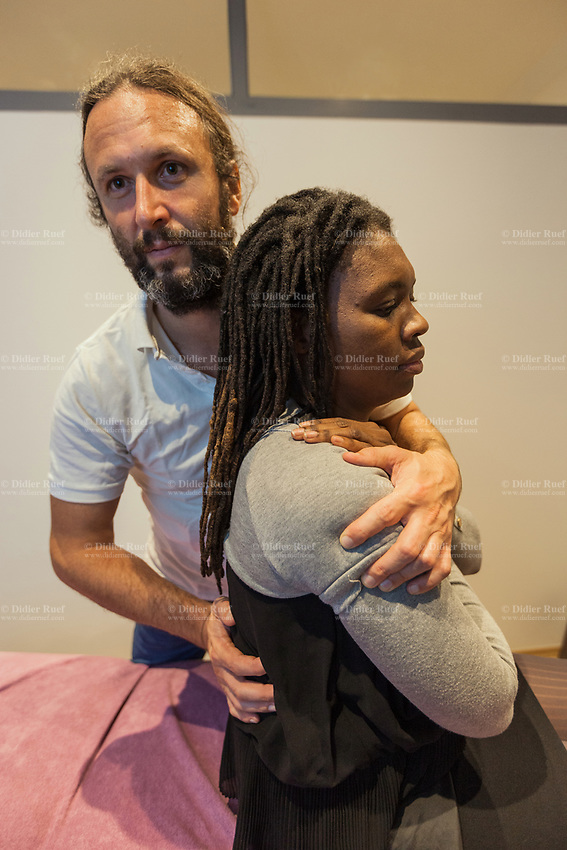 Switzerland. Geneva. Toni Srdanovic. Osteopath at work with patient. Osteopathy is a type of alternative medicine that emphasizes manual readjustments, myofascial release and other physical manipulation of muscle tissue and bones. Practitioners of osteopathy are referred to as osteopaths. 20.11.2018  © 2018 Didier Ruef