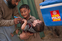 A Pakistani health officer marks a child after vaccination, during door-to-door 'Anti-polio campaign' in Karachi, Pakistan on Jan. 19, 2015