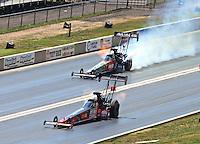 Jul. 20, 2014; Morrison, CO, USA; NHRA top fuel driver J.R. Todd (near lane) races alongside Terry McMillen during the Mile High Nationals at Bandimere Speedway. Mandatory Credit: Mark J. Rebilas-