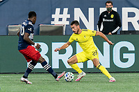 FOXBOROUGH, MA - OCTOBER 3: Daniel Lovitz #2 of Nashville SC dribbles as Cristian Penilla #70 of New England Revolution defends during a game between Nashville SC and New England Revolution at Gillette Stadium on October 3, 2020 in Foxborough, Massachusetts.