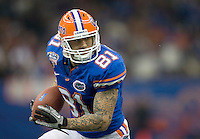 01 January 2010:  Aaron Hernandez of Florida runs the ball after catching a pass from Tim Tebow during the game against Cincinnati during Sugar Bowl at the SuperDome in New Orleans, Louisiana.  Florida defeated Cincinnati, 51-24.