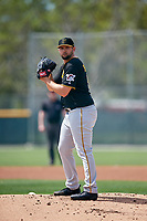 Pittsburgh Pirates starting pitcher Jake Barrett (90) gets ready to deliver a pitch during a Minor League Spring Training game against the Philadelphia Phillies on March 13, 2019 at Pirate City in Bradenton, Florida.  (Mike Janes/Four Seam Images)