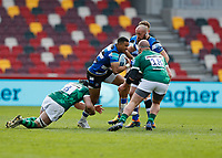 27th March 2021; Brentford Community Stadium, London, England; Gallagher Premiership Rugby, London Irish versus Bath; Anthony Watson of Bath is tackled by Matt Rogerson of London Irish