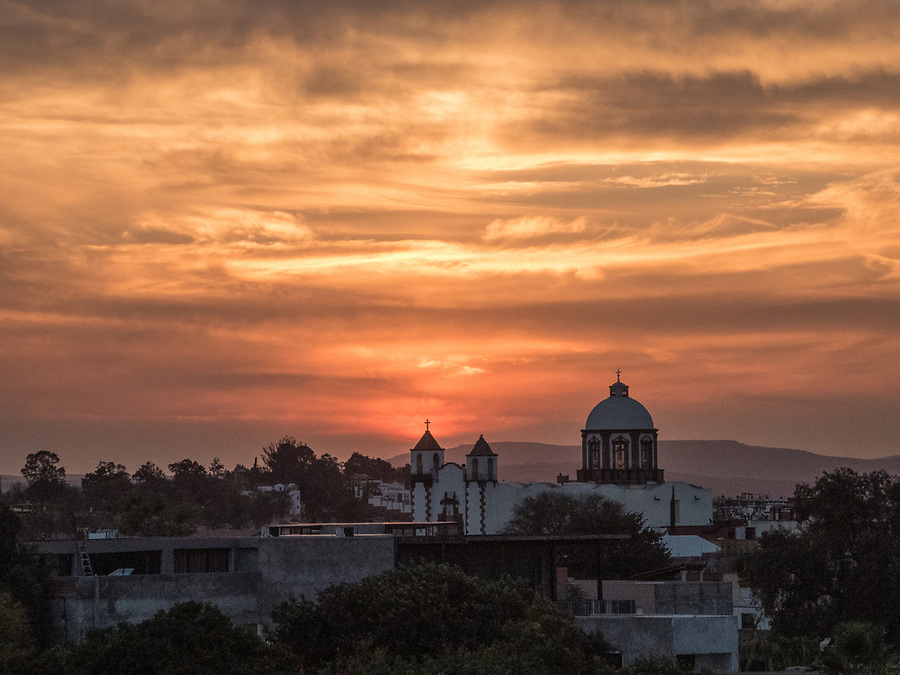 Sunset viewed from the Lunas Tapas Bar on the rooftop of the Rosewood SMA hotel.