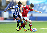 Nottingham Forest's Joe Lolley shields the ball from Sheffield Wednesday's Kadeem Harris<br /> <br /> Photographer Rich Linley/CameraSport<br /> <br /> The EFL Sky Bet Championship - Sheffield Wednesday v Nottingham Forest - Saturday 20th June 2020 - Hillsborough - Sheffield <br /> <br /> World Copyright © 2020 CameraSport. All rights reserved. 43 Linden Ave. Countesthorpe. Leicester. England. LE8 5PG - Tel: +44 (0) 116 277 4147 - admin@camerasport.com - www.camerasport.com