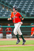 Colin Moran (14) of the Greensboro Grasshoppers jogs down the third base line on his way to scoring a run against the Augusta GreenJackets at NewBridge Bank Park on August 11, 2013 in Greensboro, North Carolina.  The GreenJackets defeated the Grasshoppers 6-5 in game one of a double-header.  (Brian Westerholt/Four Seam Images)