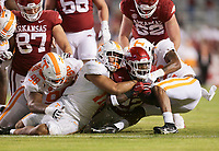 Arkansas running back Trelon Smith (22) carries the ball as Tennessee defenders block, Saturday, November 7, 2020 during the second quarter of a football game at Donald W. Reynolds Razorback Stadium in Fayetteville. Check out nwaonline.com/201108Daily/ for today's photo gallery. <br /> (NWA Democrat-Gazette/Charlie Kaijo)
