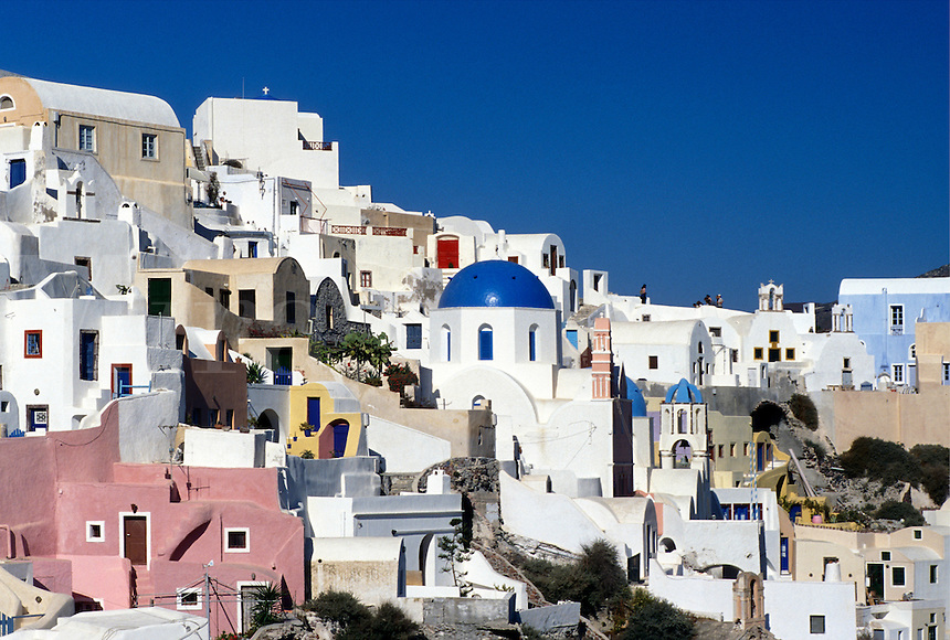 Santorini, Greece, Greek Islands, Oia, Cyclades, Europe, Village of Oia on the steep hillside of Santorini Island.
