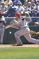 July 11, 2010: Spokane Indians' Ryan Strausborger (4) attempts to lay down a bunt during a Northwest League game against the Everett AquaSox at Everett Memorial Stadium in Everett, Washington.