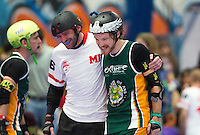 15 MAR 2014 - BIRMINGHAM, GBR - Ballistic Whistle (centre) of Team England and Flamin' Galah (right) of Wizards of Aus share a joke during half time in the bout between the two countries at the inaugural Men's Roller Derby World Cup in the Futsal Arena in Birmingham, West Midlands, Great Britain (PHOTO COPYRIGHT © 2014 NIGEL FARROW, ALL RIGHTS RESERVED)