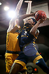 SIOUX FALLS, SD - MARCH 7: Brandon McKissic #3 of the UMKC Kangaroos takes the ball to the basket against Grant Nelson #4 of the North Dakota State Bison during the Summit League Basketball Tournament at the Sanford Pentagon in Sioux Falls, SD. (Photo by Dave Eggen/Inertia)