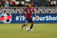 KANSAS CITY, KS - JULY 15: Miles Robinson #12  of the United States head up looking for an open team mate during a game between Martinique and USMNT at Children's Mercy Park on July 15, 2021 in Kansas City, Kansas.