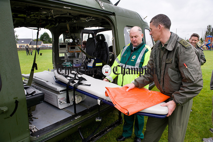 The new national Emergency Aero Medical Service Ambulance Air Corp Eurocopter paid an impromptu visit to Ennis  to meet the local ambulance crew members last Thursday. Crew member Sgt. Damien Kelly is pictured discussing the equipment  with Ennis based paramedic Pat Hanrahan. Photograph by John Kelly.
