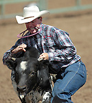 Russell Funk competes in the calf roping event at the Minden Ranch Rodeo in Gardnerville, Nev., on Sunday, July 22, 2012..Photo by Cathleen Allison