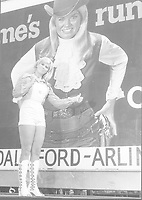 Sandy Jo Lankford, Miss UTA, in front of Miss Ford Country billboard with her picture, 1971-1972