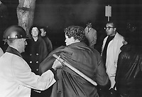 Le samedi de la matraque durant la Visite de la Reine Elizabeth II en octobre 1964<br /> <br /> <br /> A demonstrator is hustled away at the Chateau Frontenac where the royal couple were guests at a state dinner given by Quebec Premier Jean Lesage. During her visit to the city the Queen spoke on Confederation and the hope for the future and urged all Canadians to solve their problems - even if it means rewriting the constitution; which doesn't meet all needs.<br /> <br /> 1964<br /> <br /> PHOTO :  Frank Grant - Toronto Star Archives - AQP
