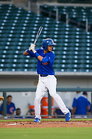AZL Cubs shortstop Luis Vazquez (18) bats during a game against the AZL Brewers on August 6, 2017 at Sloan Park in Mesa, Arizona. AZL Cubs defeated the AZL Brewers 8-7. (Zachary Lucy/Four Seam Images)