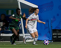 GRENOBLE, FRANCE - JUNE 22: Sara Daebritz #13 of the German National Team brings the ball forward as Chinwendu Ihezuo #19 of the Nigerian National Team pressures during a game between Nigeria and Germany at Stade des Alpes on June 22, 2019 in Grenoble, France.