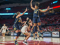 COLLEGE PARK, MD - DECEMBER 28: Akienreh Johnson #14 of Michigan leaps high over Diamond Miller #14 of Maryland. during a game between University of Michigan and University of Maryland at Xfinity Center on December 28, 2019 in College Park, Maryland.