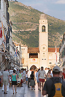 The main street Stradun Placa with traditional houses and flocks of tourists, view over clock tower and loggia on the central square Dubrovnik, old city. Dalmatian Coast, Croatia, Europe.