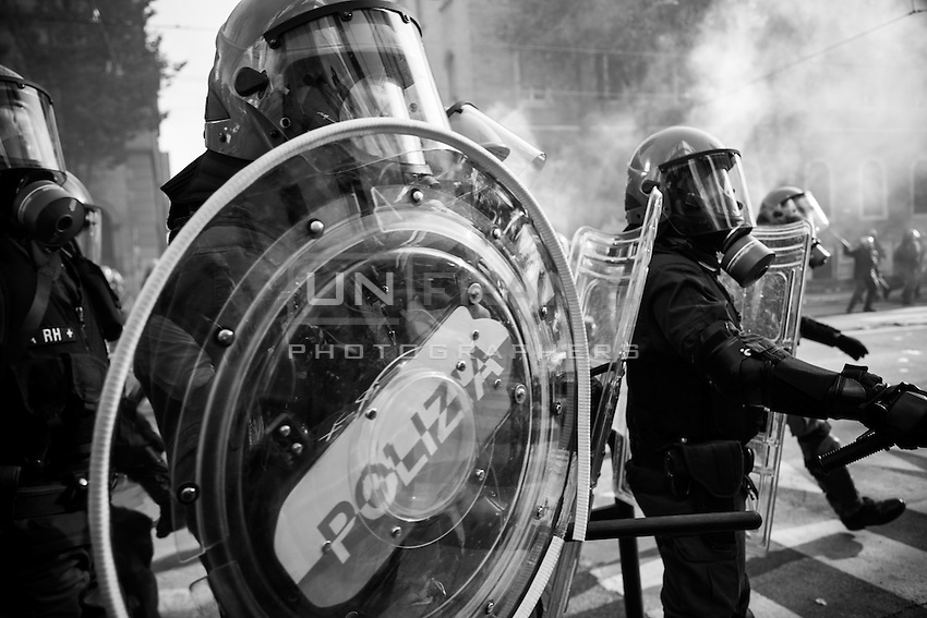 Policemen in riot gear during the urban guerilla triggered by black blocs fringes. Rome, Italy. 15/10/2011