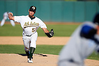 Phoenix Desert Dogs pitcher Brett Hunter #51, of the Oakland Athletics organization, during an Arizona Fall League game against the Surprise Saguaros at Phoenix Municipal Stadium on October 18, 2012 in Phoenix, Arizona.  The game was called after eleven innings with a 2-2 tie.  (Mike Janes/Four Seam Images)