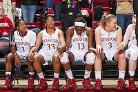 Stanford players watch the last minutes of Stanford women's basketball  vs Washington State game at Maples Pavilion, Stanford, California on March 1, 2014.