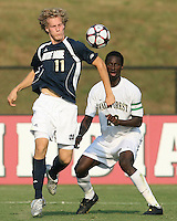 04 September 2009: Steven Perry #11 of the University of Notre Dame pulls down the ball in front of Ike Opara #23 of Wake Forest University during an Adidas Soccer Classic match at the University of Indiana in Bloomington, In. The game ended in a 1-1 tie..