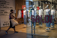 Milan, Italy , july 3 2021 - first day of summer sales - corso vittorio emanuele shops