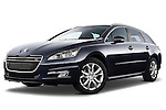 Low aggressive front three quarter view of 2012 Peugeot 508 SW Allure Wagon Stock Photo