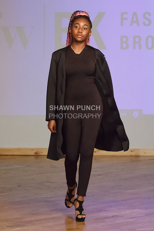 Model walks runway in outfit from the William H. Maxwell CTE High School Fall Winter 2018 collection, at the Young Designers Showcase for Fashion Week Brooklyn Fall Winter 2018 at The Automatic Studios, on April 10, 2018.