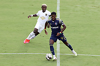 CARY, NC - AUGUST 01: Hadji Barry #92 keeps the ball away from Anderson Asiedu #6 during a game between Birmingham Legion FC and North Carolina FC at Sahlen's Stadium at WakeMed Soccer Park on August 01, 2020 in Cary, North Carolina.