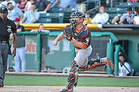 Max Stassi (12) of the Fresno Grizzlies  throws to second base between innings in action against the Salt Lake Bees at Smith's Ballpark on June 13, 2015 in Salt Lake City, Utah.  (Stephen Smith/Four Seam Images)