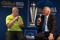 13.06.2014. London, England.  Rileys Sports Bar, Haymarket. The  launch of William Hill's sponsorship as title sponsor of the 2015 World Darts Championship. Reigning World Darts Champion Michael van Gerwen [L], PDC Chairman Barry Hearn [R].