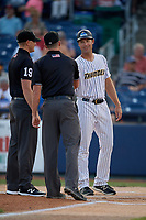 Trenton Thunder manager Pat Osborn (13) shakes hands with umpires Mike Snover (left) and Aaron Higgins before an Eastern League game against the New Hampshire Fisher Cats on August 20, 2019 at Arm & Hammer Park in Trenton, New Jersey.  New Hampshire defeated Trenton 7-2.  (Mike Janes/Four Seam Images)