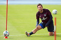 Frank Lampard of England stretches during training
