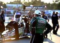 Aug 15, 2014; Brainerd, MN, USA; NHRA funny car driver John Force looks on as daughter Brittany Force prepares to race during qualifying for the Lucas Oil Nationals at Brainerd International Raceway. Mandatory Credit: Mark J. Rebilas-USA TODAY Sports