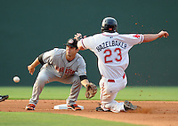 Second baseman Jeff Kobernus (37) of the Hagerstown Suns waits for the ball to tag Jeremy Hazelbaker (23) of the Greenville Drive attempting to steal in a game on July 8, 2010, at Fluor Field at the West End in Greenville, S.C. Photo by: Tom Priddy/Four Seam Images