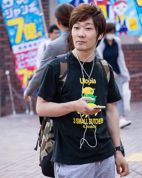 A man waiting near popular meeting place in Shinjuku.