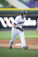 Mason Robbins (10) of the Winston-Salem Dash takes his lead off of third base against the Potomac Nationals at BB&T Ballpark on May 13, 2016 in Winston-Salem, North Carolina.  The Dash defeated the Nationals 5-4 in 11 innings.  (Brian Westerholt/Four Seam Images)