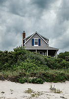 Beach house during pending storm, Cape Cod, Massachusetts, USA.