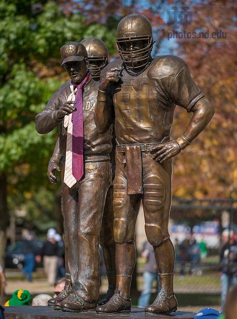 Oct 11, 2014; The Lou Holtz statue outside ND Stadium sports neckties. (Photo by Matt Cashore)