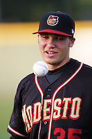 April 14, 2010: David Christensen of the Modesto Nuts before game against the Rancho Cucamonga Quakes at The Epicenter in Rancho Cucamonga,CA.  Photo by Larry Goren/Four Seam Images