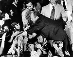 """President Gerald Ford goes into crowd shaking hands during campaign, President Gerald Ford, President and Betty Ford second son, John """"Jack"""" Gardner Ford hold coat of President Gerald Ford from falling in crowd during campaign, <br /> President Gerald Ford Photo by Ron Bennett, Fine Art Photography by Ron Bennett, Fine Art, Fine Art photography, Art Photography, Copyright RonBennettPhotography.com ©"""