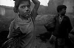 A young girl and her brother from the coal mining area of Jharia, Jharkhand, India. Arindam Mukherjee